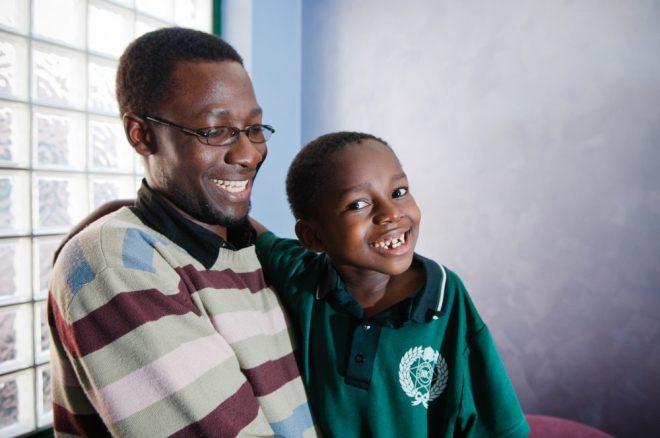 Pastor Peter Sewakiryanga and George.