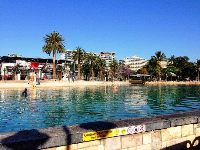 Swimmers enjoying an early morning dip at South Bank beach before the crowds arrive.