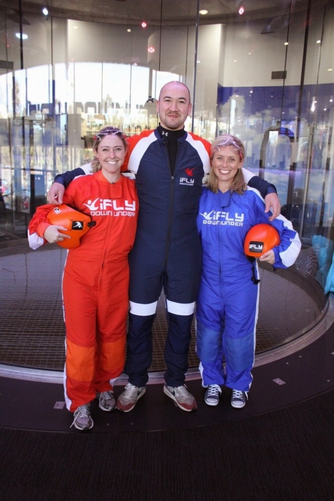 Erin, our instructor Frazer and I ... Erin and I might look like the world's tiniest astronauts but we were mad indoor skydivers (well ... kind of).