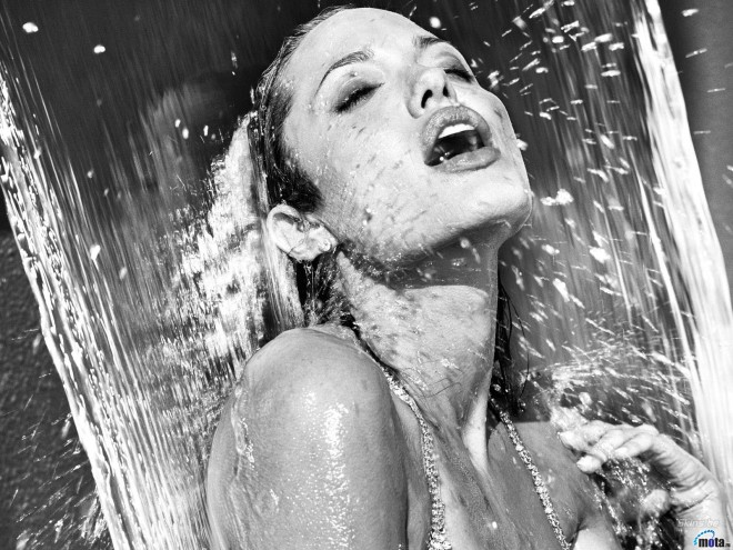 Yes, that is Angelina Jolie looking smoking hot under a waterfall.