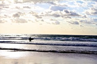 Gold Coast surfer at sunrise