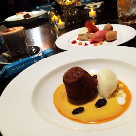 Steamed Christmas fruit pudding with vanilla custard and Nougat praline parfait with warm strawberry filled donuts from Blackbird.