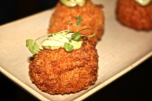 Semi-dried tomato and bocconcini arancini with basil pesto aioli.