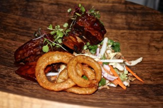 Vietnamese Braised Beef Short Ribs with Urban slaw, coriander, fried shallots and onion rings.