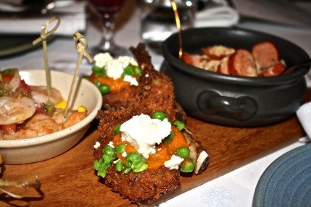 Crumbed lamb cutlet with pumpkin puree, crushed pea and feta from Navala Churrascaria.