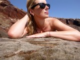 Channeling my inner mermaid at Santorini's famous Red Beach.