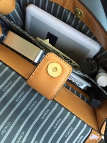 The WiWander easily fit into my clutch bag.