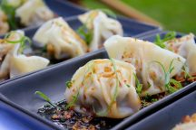 Queensland pork belly and black garlic dumplings, XO sauce from Cove.