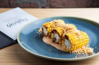 Charred corn on the cob with Crispy pork crumb and spicy buttermilk remoulade. Photo: Judit Losh