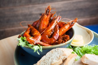 Old bay prawns with lemon and baguette. Photo: Judit Losh