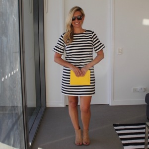Striped_dress_yellow_clutch